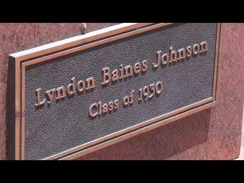 picture of Lyndon Baines Johnson's nameplate under the statue of him on Texas State campus