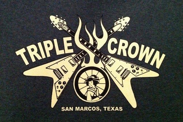 Triple Crown crossing guitars on fire