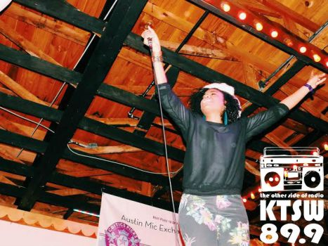 """Anya beckons the Weird City Crowd to sing along to """"Black Girl."""" Photo by Kendra Sells."""