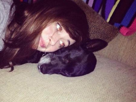 Sydney huddleston with her dog, Callie.