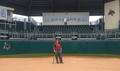Kendall Wiley stands in Bobcat Ballpark. Photo by Brooke Adams.