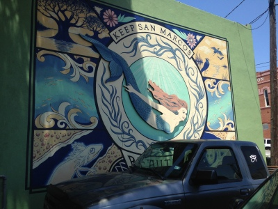 The Dive into the Divine Mural is located on the back of the Root Cellar Bakery. Photo by Holly Henrichsen.