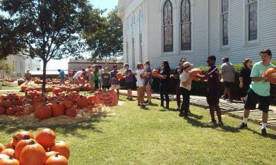 The San Marcos community helps unload the truck with all of the pumpkins each year. Photo by Austin Cowan.