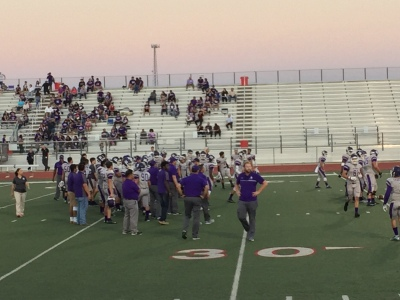 The Rattlers warm up before their game against the Del Valle Cardinals. Photo by Kyle Spencer.