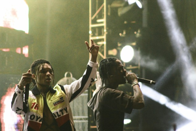 "Travis Scott invites Rae Sremmurd on stage to perform ""Swang"". Photo by Kendra Sells."