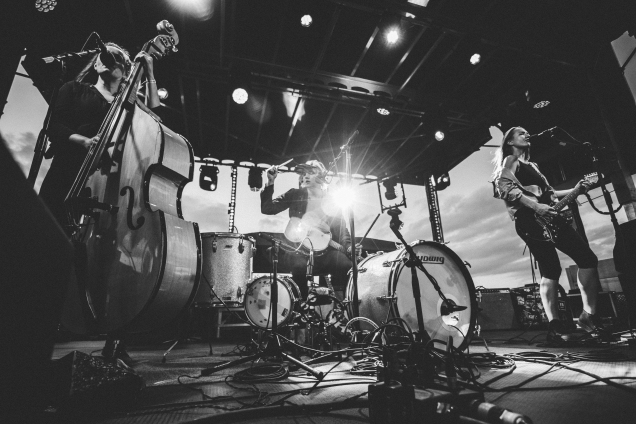 Wide photo of the band Baskery during their insane performance.