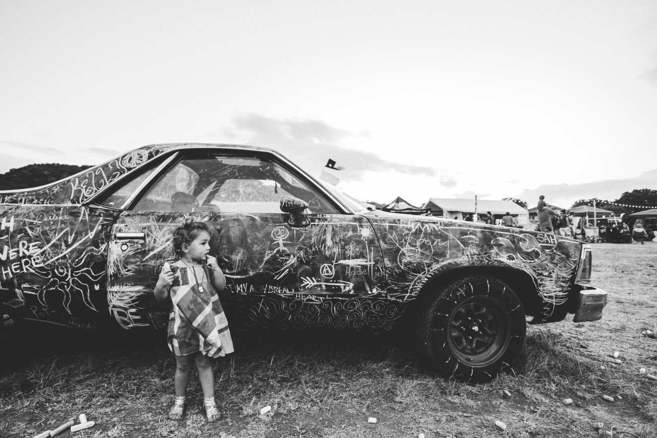 This car was set in the middle of the festival and people were able to write/draw anything they please with chalk.