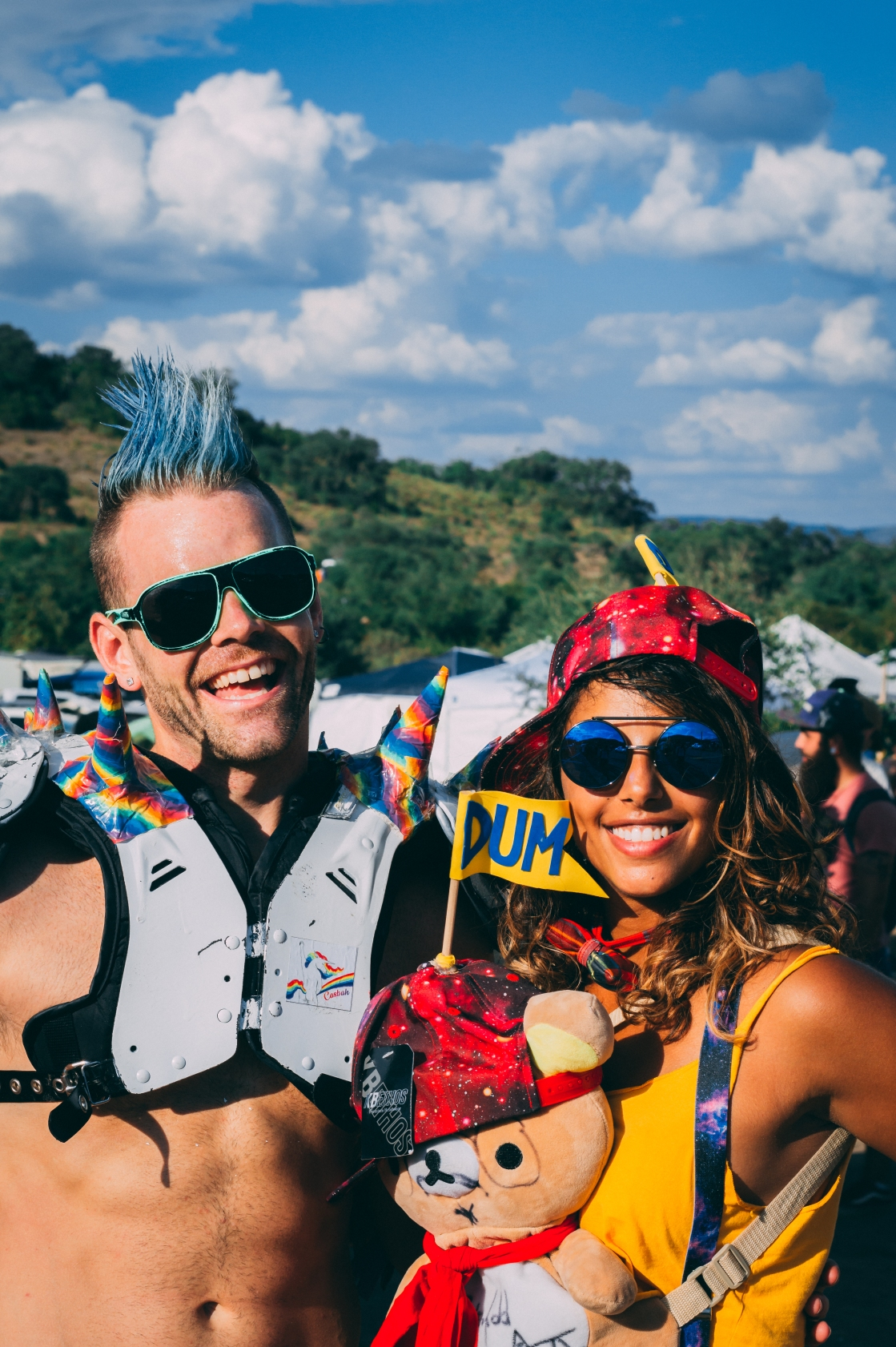 """Decked out in rave gear, ironically, Tommy and Christina don't attend raves too often. """"This kind of music (UTOPiA Fest) is more of her thing,"""" said Tommy."""