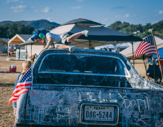 This little boy is a brave soul for climbing on the roof of this car. I was amazed at how adventurous the children at UTOPiA Fest were.