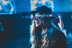 KTSW's Alex Sereno attends Lights All Night to cover the festival over social media. Taking a break from her duties, Sereno has some fun trying on kaleidoscope goggles.