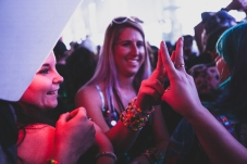 Two friends exchange bracelets during Seven Lions' set on December 30, 2017. The bracelet (kandi) exchange is a principle practice of the rave culture. It symbolizes the bond that the two participants have created.