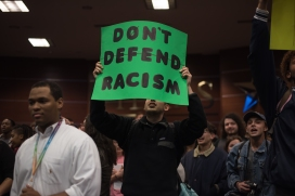 Students hold signs regarding racism on campus and Clegg specifically.