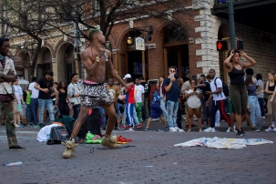 No street performer is complete without shiny pants and doggy shoes.