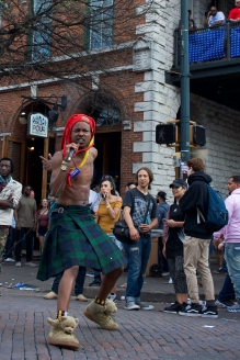 Wearing a crazy hat and a kilt, this street performer gathered a large crowd.