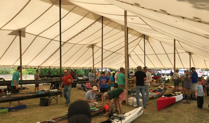 Racers having their canoes inspected to make sure they are competition ready.