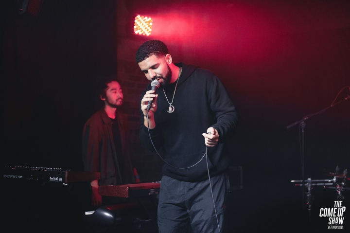 Drake singing into the mic