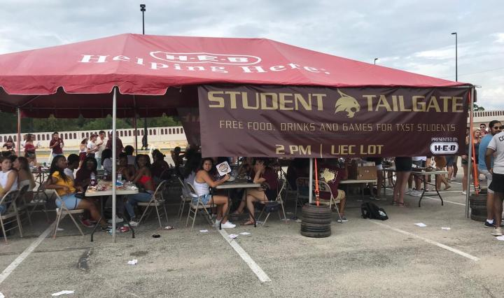 Student Tailgate tent outside Bobcat Stadium providing free food and beverages.