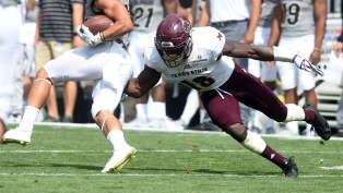 Texas State University's Linebacker Frankie Griffin dives for a tackle