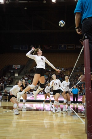 Texas State's Cheyenne Huskey cocks her right arm back to go for the kill against UTSA.