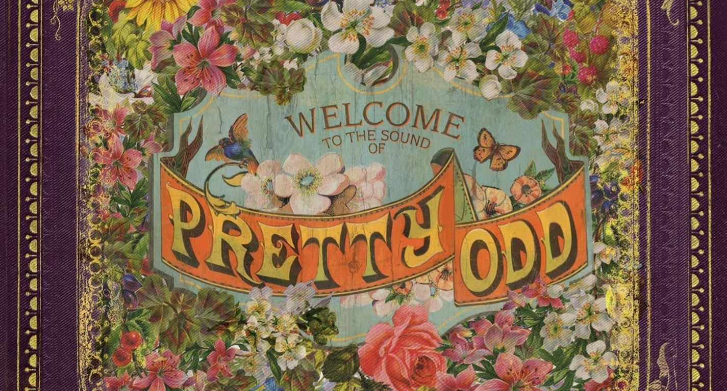 """A wreath of colorful flowers within a frame. In the center it says """"Welcome to the sound of Pretty. Odd"""""""