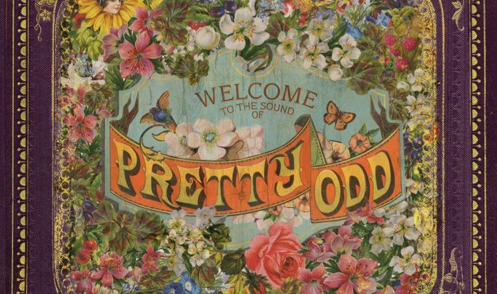 "A wreath of colorful flowers within a frame. In the center it says ""Welcome to the sound of Pretty. Odd"""