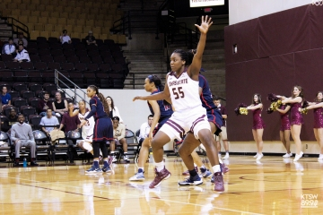 Texas State women's basketball player #55 dominates the court.