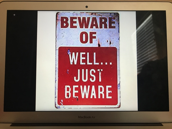 "a laptop with a screen that says ""Beware Of...Well...Just Beware."""