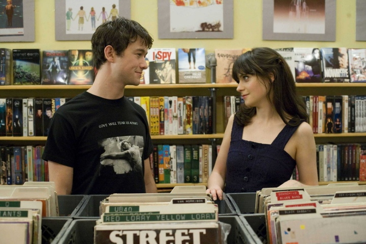The two main characters shop for records and converse about their thoughts on The Beatles