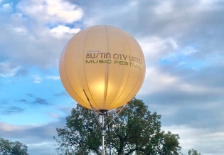 "An air balloon light that says ""Austin City Limits"""