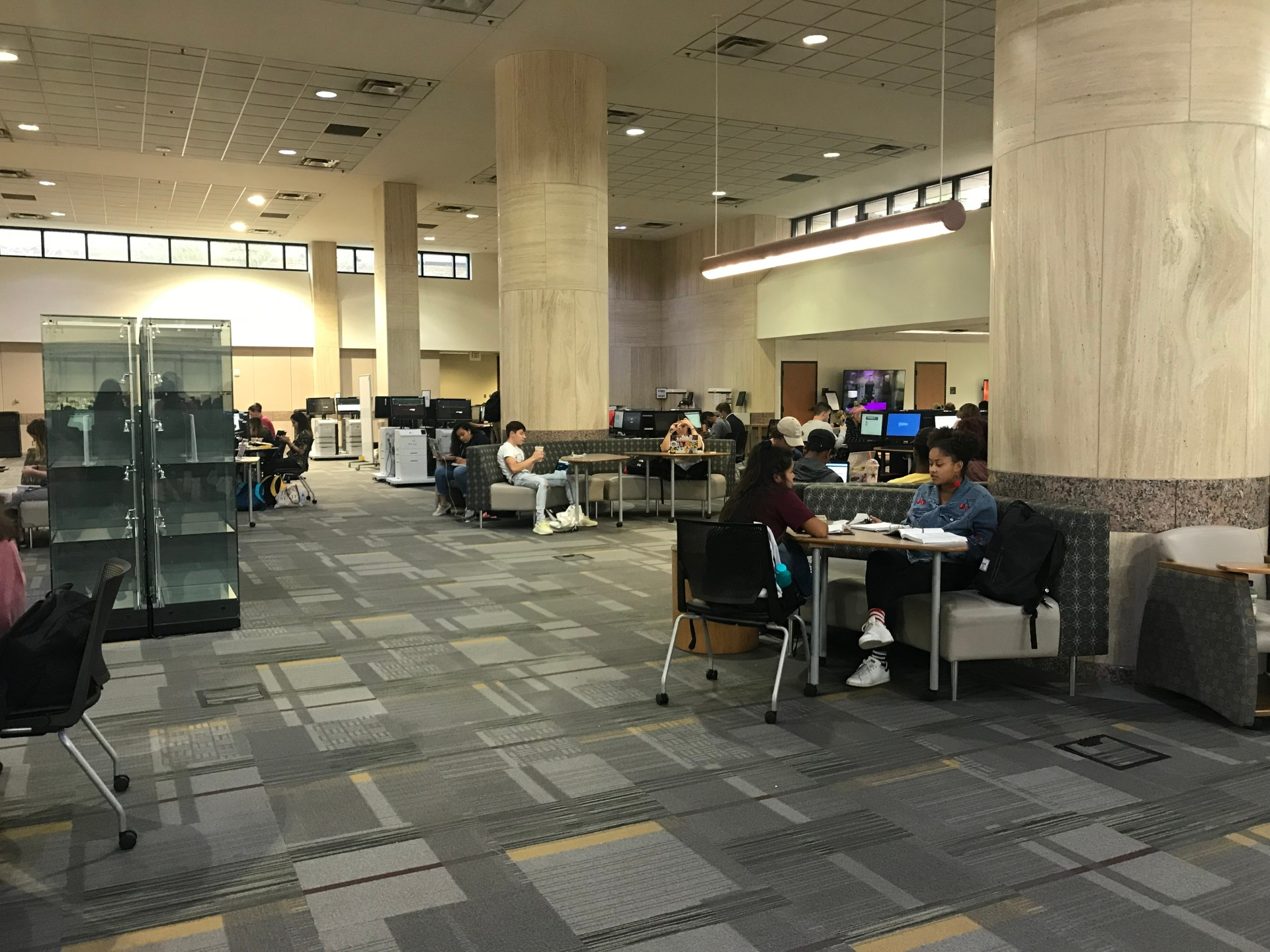 Students sitting in Alkek Library
