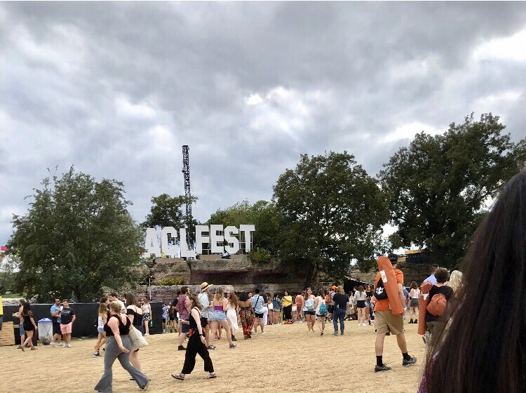 "People walking near a sign that says ""ACL Fest"""