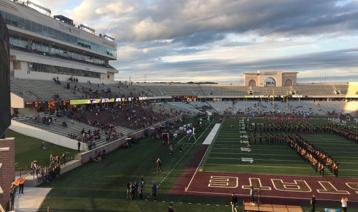 A football field with mostly empty stands.