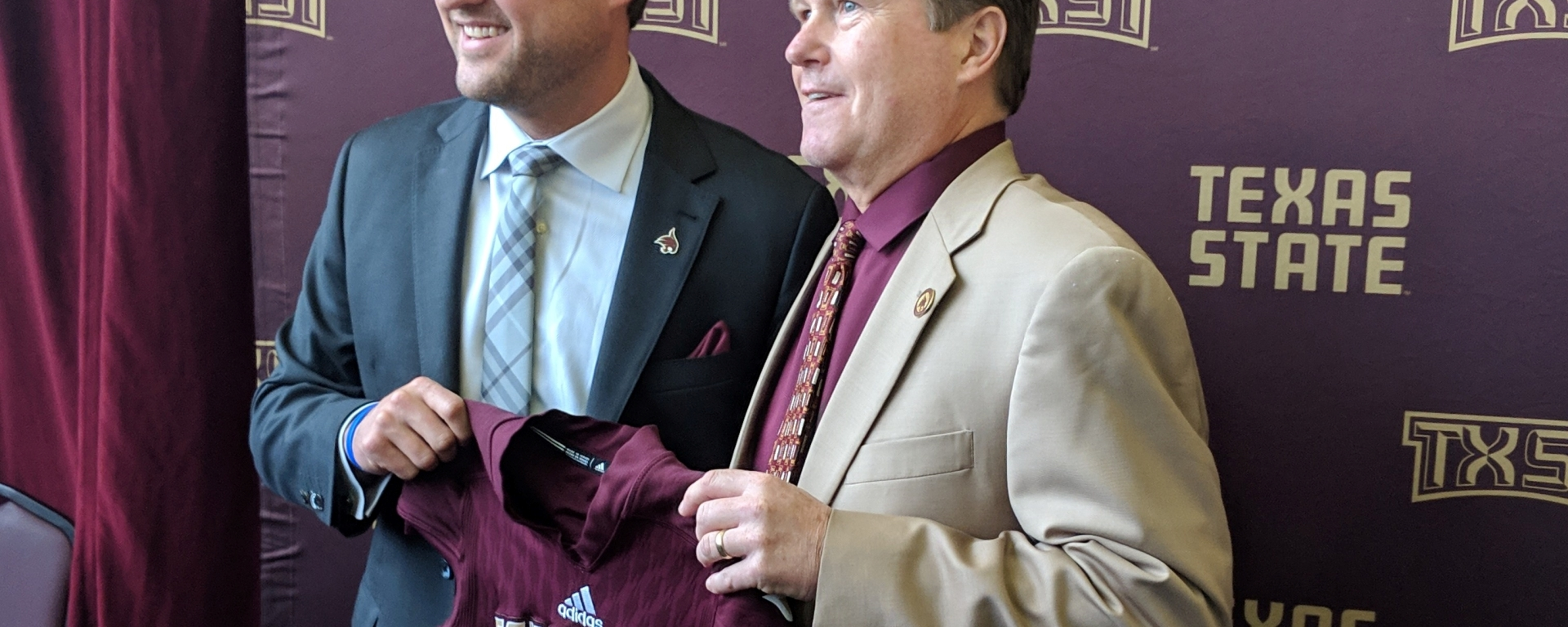 Texas State Athletic Director Larry Teis introduces Head Coach Jake Spavital to the media