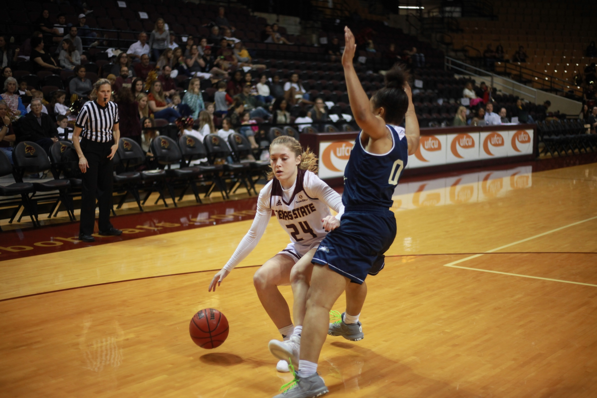 Starting Guard Brooke Holle drives to the hoop knocking down two of her seventeen total points