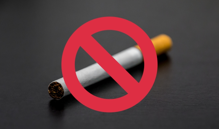 The image is of a cigarette with a red circle-backslash symbol on top of it.