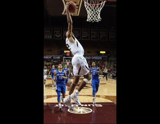 Pearson mid-jump as he slam dunks.