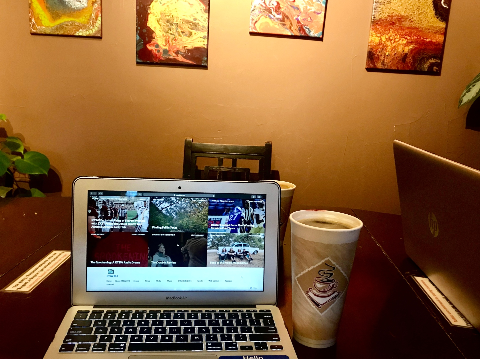a picture of a laptop and a coffee on a table