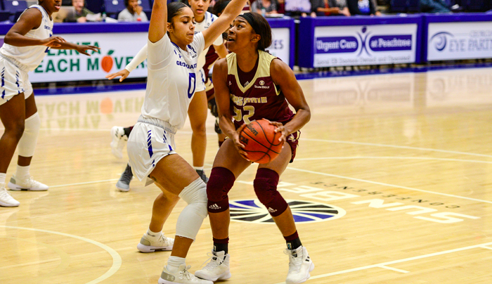A Texas State player squares off against a Georgia State player.
