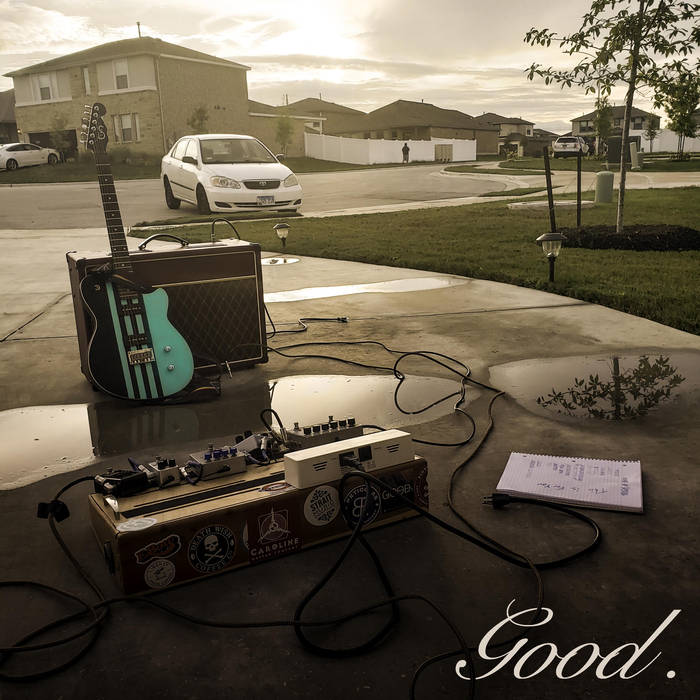 The album cover is a photo of a driveway with a tiffany blue electric guitar, resting up against an amplifier. There is also a notebook and a puddle of water with a tree reflecting on to it. In the background of the picture you see a white car parked in front of the driveway.