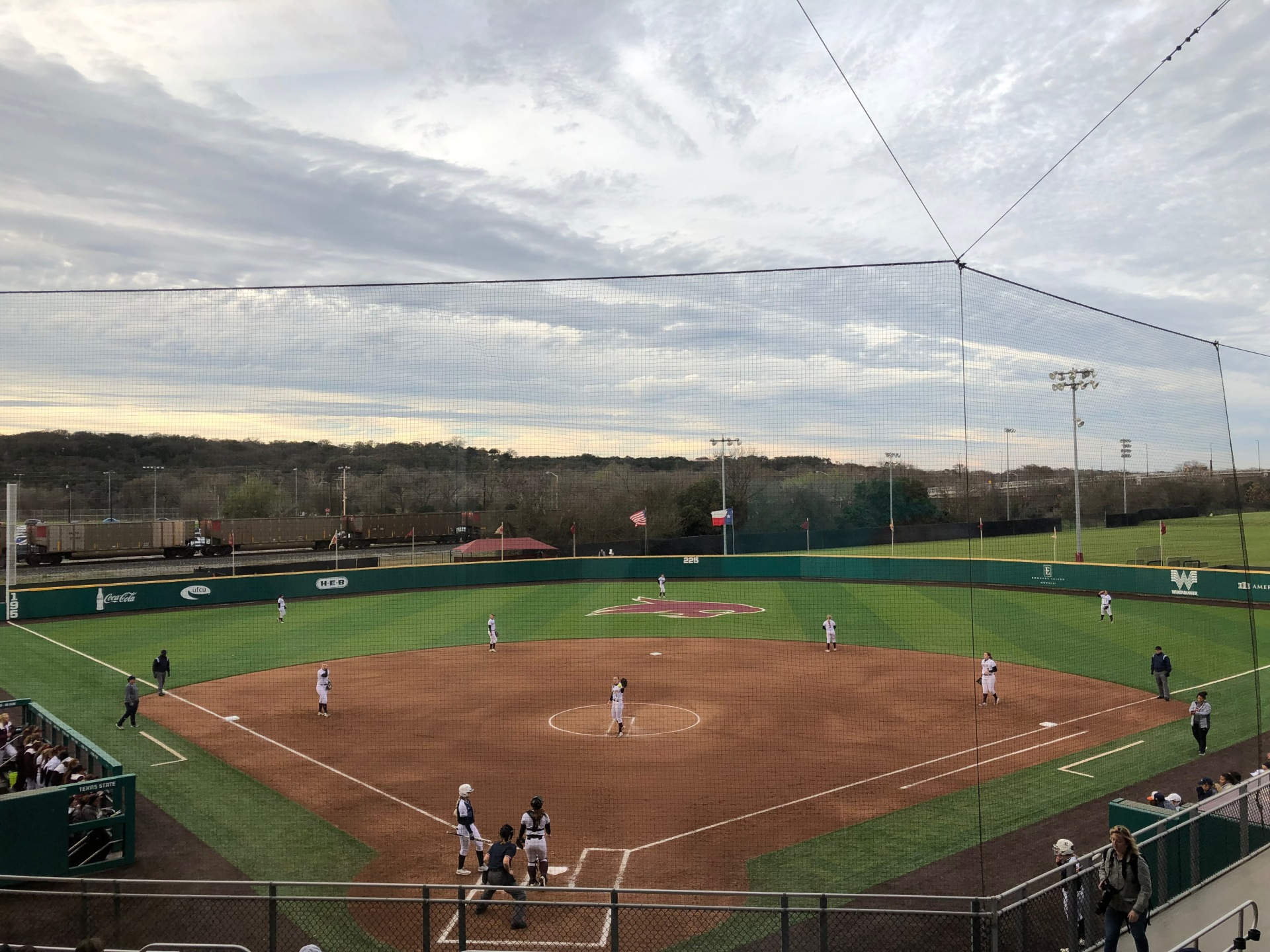 A wide shot of the Bobcat baseball stadium with players on the field.