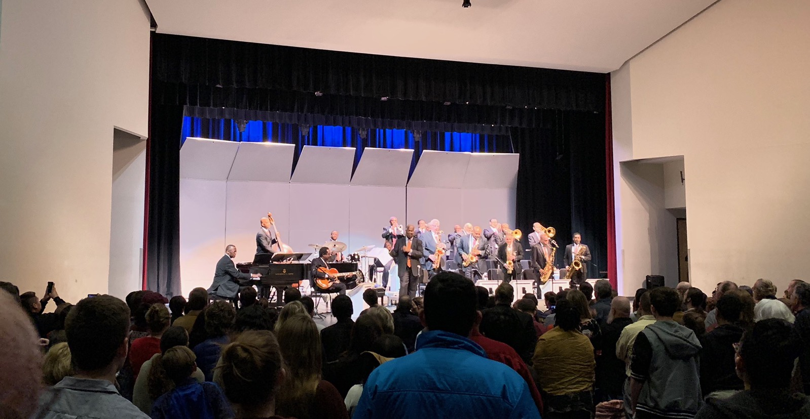 The Count Basie Orchestra playing their last song at Evans Auditorium at Texas State University with the crowd standing.