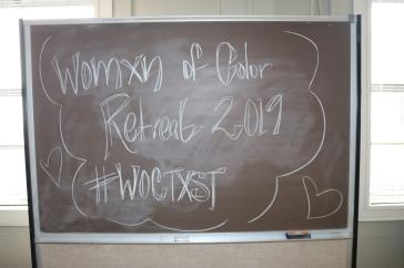 Womxn of Color Retreat 2019 , #WOCTXST drawn on a black chalkboard