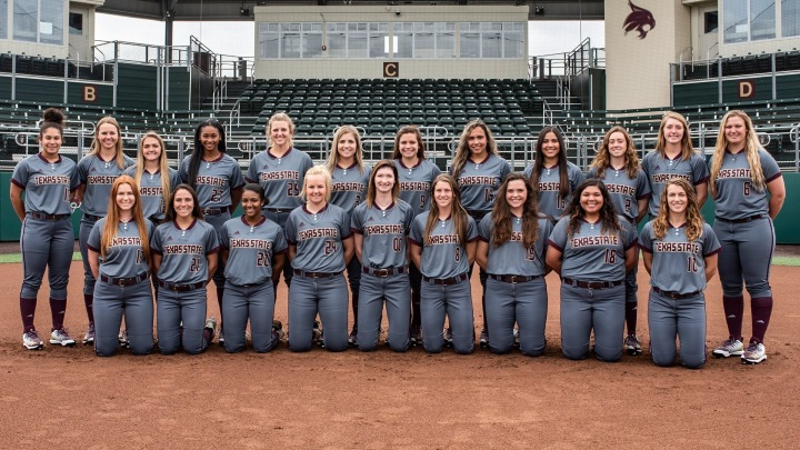 The Texas State softball team poses in two rows for a team photo.