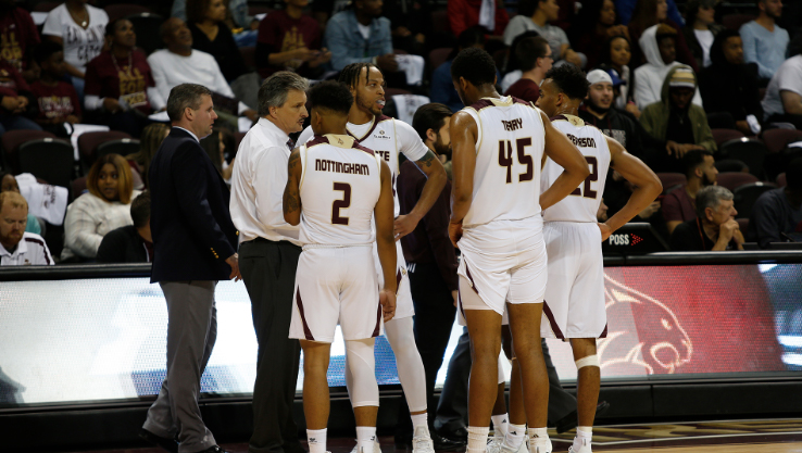 Guards Tre Nottingham and Nijal Pearson along with forwards Eric Terry and Alex Peacock join head coach Danny Kaspar in the huddle during a Texas State basketball in Strahan Arena.