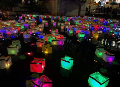 Hundreds of lit lanterns of various bright colors fill the San Antonio River.