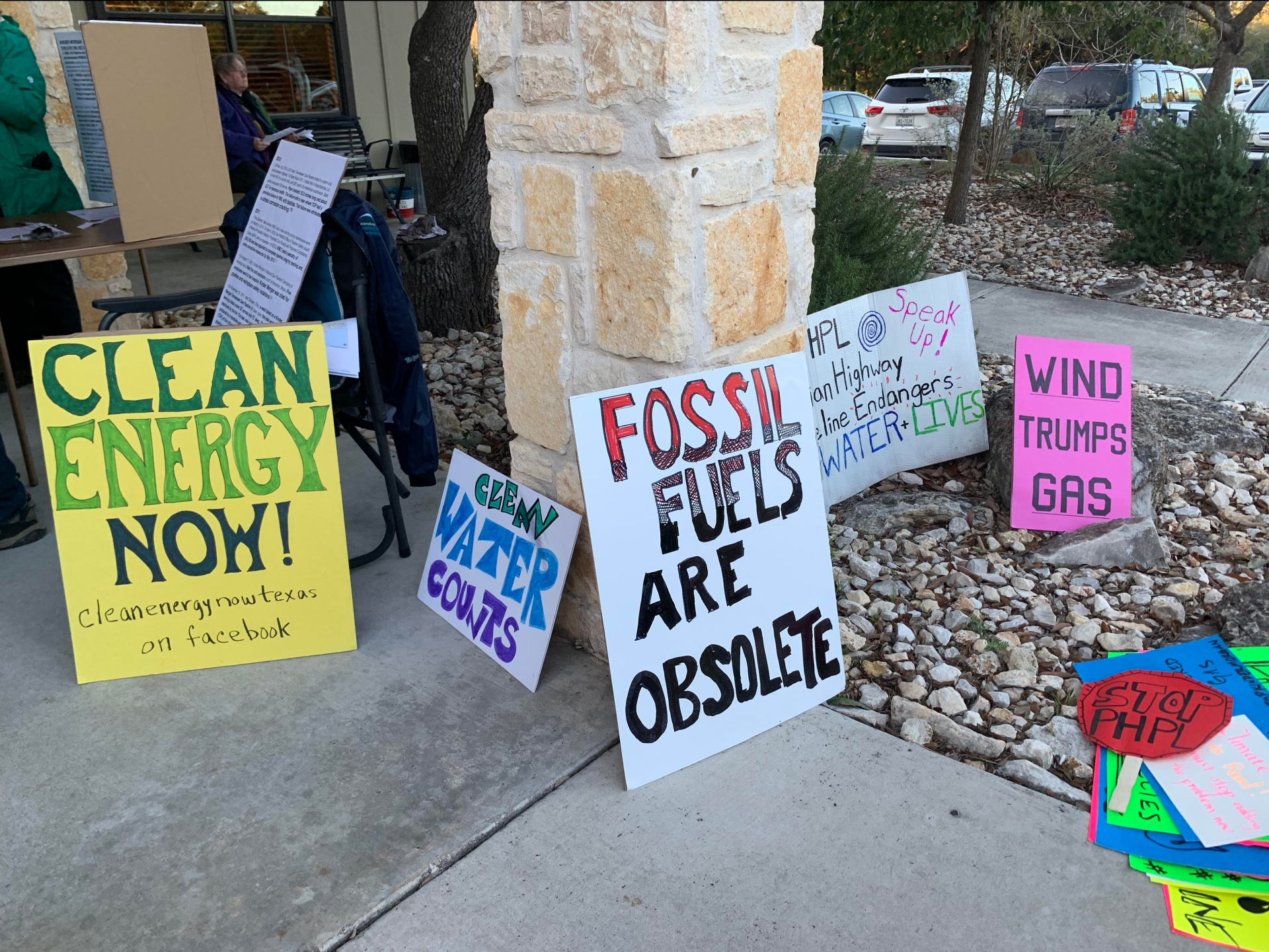 Signs that are anti-pipeline such as clean energy now are placed along the Wimberley Community Center