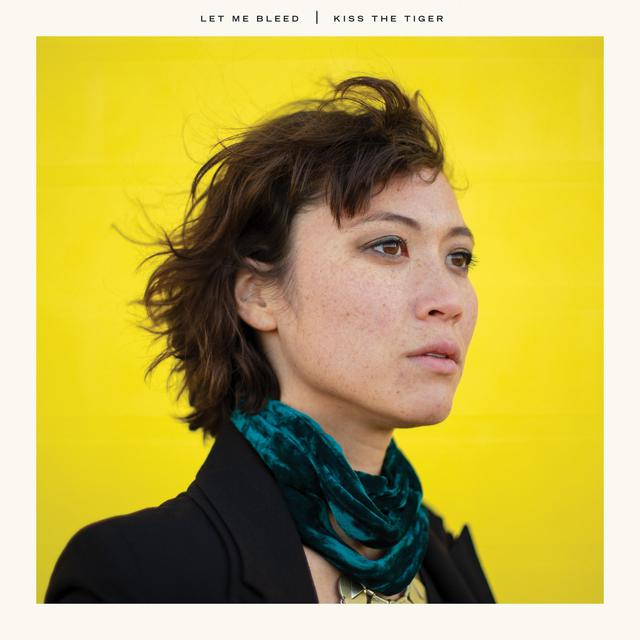 The album cover is a gorgeous side profile of Kiss the Tiger's lead singer, Meghan Kreidler on an all yellow background