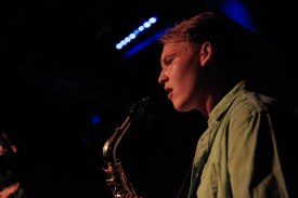 Thomas Webb just finished playing the saxophone for a song with the OOey Gooeys