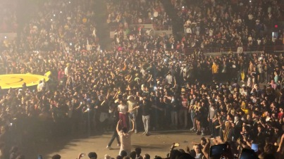 Two separate mosh pits coordinating to become a giant one