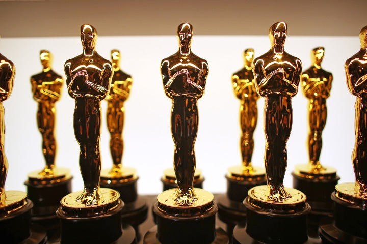 Rows of golden Oscar statuettes